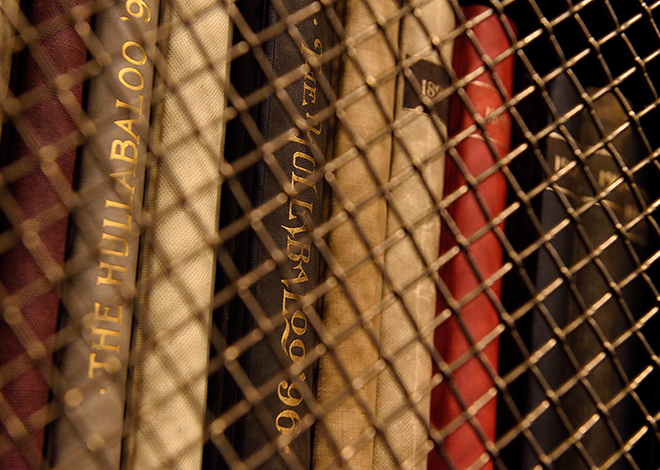 Archival books in caged shelving