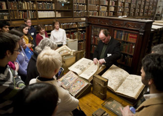 Special collections curator show books to a class